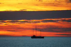 Yacht at sea sunset Stock Image