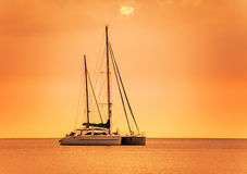 Yacht in the sea at sunset Stock Photography