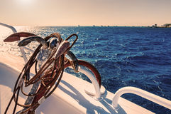 Yacht in the sea at sunset Stock Photos