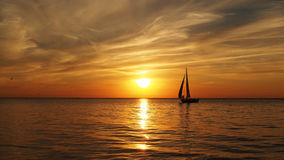 Yacht on sea and orange clouds on sunset Stock Photography