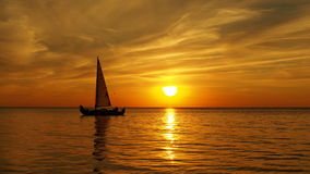 Yacht on sea at orange sunset Royalty Free Stock Image