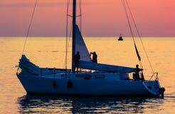 Yacht on sea sunset Royalty Free Stock Photos