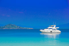 Yacht in the sea. White yacht in the blue tropical sea Royalty Free Stock Images