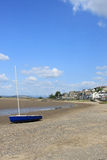 Yacht on seashore at Arnside, Cumbria, England. Stock Image