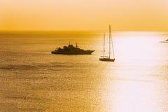 Yacht and ships at Porto Rotondo Costa Smeralda Sardinia. Sunrise with yacht and ships at Porto Rotondo on Costa Smeralda at Mediterranean sea, Sardinia, Italy stock photos