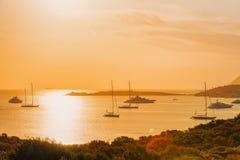 Yacht and ships Porto Rotondo Costa Smeralda Sardinia. Sunrise with yacht and ships in Porto Rotondo on Costa Smeralda at Mediterranean sea, Sardinia, Italy royalty free stock photo