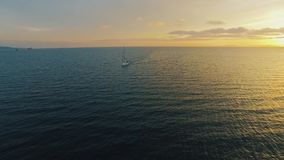 Yacht shoot by drones in the sea at sunset stock footage