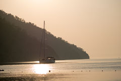 Yacht silhouette Sunrise time Turkey. Summer time Turkey Yacht Sunrise silhouette above sea and sky Stock Image