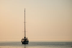 Yacht silhouette Sunrise time Turkey. Summer time Turkey Yacht Sunrise silhouette above sea and sky Royalty Free Stock Photo