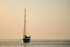 Yacht silhouette Sunrise time Turkey. Summer time Turkey Yacht Sunrise silhouette above sea and sky Stock Photo