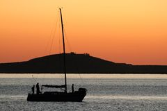Yacht silhouette at sunset Stock Photos