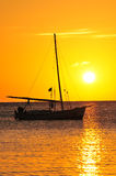 Yacht silhouetted at sunset Royalty Free Stock Image
