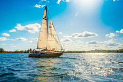 Yacht. Small yacht in blue water, sunny cloudy sky Royalty Free Stock Photo