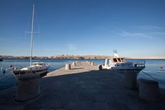 Moored boats at a pier at adriatic coast in Croatia stock photo