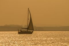 A yacht in sparkly waters Stock Images