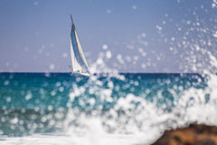 Yacht and splashes Royalty Free Stock Photos
