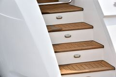 Yacht stair. Stair made in wood of yacht in deep color, shown as marine activity and facilities, travel or holiday entertainment Stock Image
