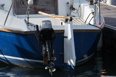 Yacht stern moored with outboard Stock Photo