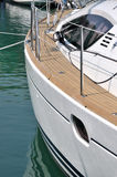 Yacht stop in harbor. Deck and body of a white yacht which stop in harbor, shown as marine activity, travel or in maintenance Royalty Free Stock Image
