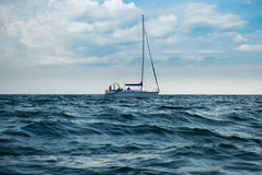 Yacht in a stormy sea Royalty Free Stock Image