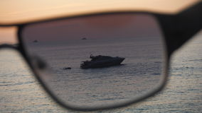 Yacht through the sunglasses Royalty Free Stock Photo