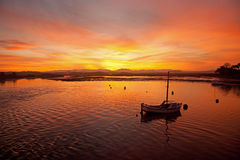A yacht in the  Sunrise at Four Mile Bridge Stock Photo