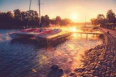 Yacht in sunrise lake Stock Photo