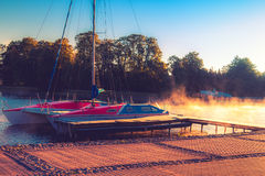 Yacht in sunrise lake Royalty Free Stock Images