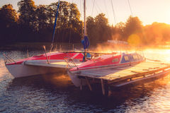 Yacht in sunrise lake Royalty Free Stock Photos