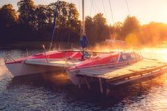 Yacht in sunrise lake Royalty Free Stock Photos