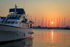 Yacht at sunrise at Mandraki harbor royalty free stock photo