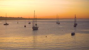 Yacht at sunrise in ocean bay. Magical seascape stock footage