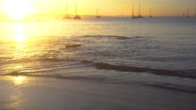 Yacht at sunrise in ocean bay. Magical seascape stock video footage