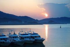 Yacht at sunset. A beautiful sunset Yacht Marina Royalty Free Stock Image