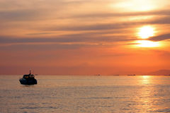 Yacht at sunset. Sunset at sea with shipping boat silhouette Stock Images