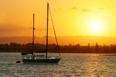 Yacht At Sunset Royalty Free Stock Photos