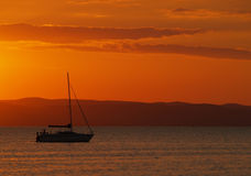 Yacht in sunset. Yacht sailing in Balaton in sunset Royalty Free Stock Images