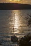 Yacht at sunset Stock Photo