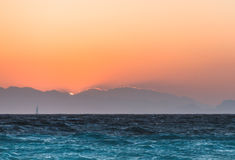 Yacht at sunset in the Aegean Sea. Rhodes Island. Greece Royalty Free Stock Photo
