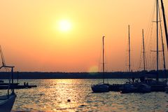 Yacht at sunset. Sunset in the Yacht Club on the coast Royalty Free Stock Photo