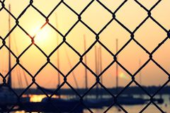 Yacht at sunset. Sunset in the Yacht Club for fence Stock Photo