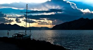Yacht at sunset in Greece Stock Photo