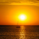 YACHT ON THE SUNSET HORIZON Stock Image