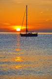 Yacht with sunset at sea Stock Photos