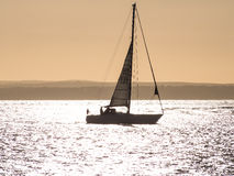 A yacht at sunset in the Solent Stock Photo