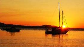 Yacht at Sunset. This sunset is at The Town of Seventeen Seventy 1770 in Australia Stock Image