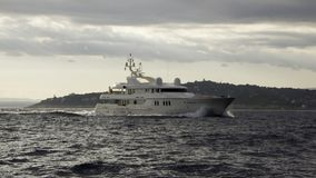 Yacht Teddy. Motor yacht Teddy in late afternoon steaming in front of Cap Ferrat Stock Photos