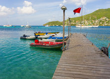 Yacht tenders at a wooden jetty in the caribbean Stock Image