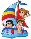 Yacht with three kids Stock Photo