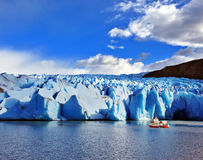 Yacht for tourists near the Glacier Grey royalty free stock image